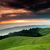 """Mt Tamalpais Sunset"" <br>Location: Mt. Tamalpais, San Francisco, California.  <p></p><p>There is nothing better than being on a quiet hillside watching sunset. Fortunately, not far from where I stay, Mt. Tamalpais in San Francisco offers such a vantage point. So when the lighting conditions were just right I decided to capture this view forever.  </p><p>Tech Info and Tip: <br>Lens: Canon 17-40mm f/4L @40mm <br>Camera: Canon 5D Mk II <br>Exposure: 6/10sec at f/13 and ISO 200 <br>Filters: SinghRay 2 stop hard edge and 3 stop hard edge ND filters stacked together  </p><p>The grass is green for a very short time of the year. But golden grass on the hills look equally good. I am hoping to return to this spot again next year and try some of those shots.  <br><br>San Francisco is a busy metropolitan area but just a few miles to the north exists a place so quiet and unique that it is such a perfect escape from the chaos of the city life. Mt. Tam, as it is locally know, is a perfect vantage point to watch the summer fog rolling into the bay or just enjoy the hike on its undulating hills and redwood forests.</p>"