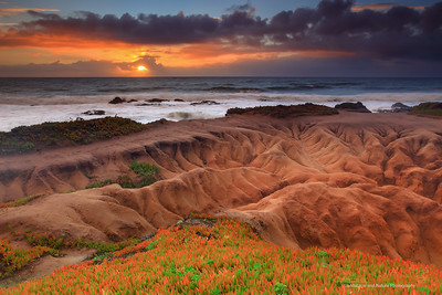 """Badlands of Pescadero"" Location: Pescadero State Beach, California. [GPS/Map]  This image has been many years in the making. Believe it or not, I have been to this particular spot a countless times but never witnessed a sunset like this one.  The eroding patterns on the coastline are unique here. The ground below feels just like compacted sand to me and every rainstorm take a little bit away slowly creating these watershed pattern.  The erosion here can be quite fast and the landscape looks different to me every year I visit. So visit soon if you can... it's incredible as is to watch the sunset on Pacific coast but it can be even more amazing to watch it from the coastline of Pescadero state beach.  Tech Info: Lens: Canon EF 17-40mm f/4 L @ 25mm Camera: Canon EOS 5D Mk II Exposure: 0.6sec at f/13 and  ISO 50 Filters: LEE 0.9 (3-stop) ND Grad + SinghRay 3-stop Reverse ND Grad Processng: All processing wass done in Lightroom 4. The sky gets bit more warm color temperature. The foreground gets bit more exposure... that's pretty much it other than dust removal, sharpening and noise reduction. Enjoy!"