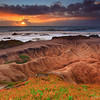 """Badlands of Pescadero"" <br>Location: Pescadero State Beach, California. [<a href=""http://g.co/maps/mcwqa"">GPS/Map</a>]  <p>This image has been many years in the making. Believe it or not, I have been to this particular spot a countless times but never witnessed a sunset like this one.  <p>The eroding patterns on the coastline are unique here. The ground below feels just like compacted sand to me and every rainstorm take a little bit away slowly creating these watershed pattern.  <p>The erosion here can be quite fast and the landscape looks different to me every year I visit. So visit soon if you can... it's incredible as is to watch the sunset on Pacific coast but it can be even more amazing to watch it from the coastline of Pescadero state beach.  <p>Tech Info: <br>Lens: Canon EF 17-40mm f/4 L @ 25mm <br>Camera: Canon EOS 5D Mk II <br>Exposure: 0.6sec at f/13 and  ISO 50 <br>Filters: LEE 0.9 (3-stop) ND Grad + SinghRay 3-stop Reverse ND Grad <br>Processng: All processing wass done in Lightroom 4. The sky gets bit more warm color temperature. The foreground gets bit more exposure... that's pretty much it other than dust removal, sharpening and noise reduction. Enjoy!"