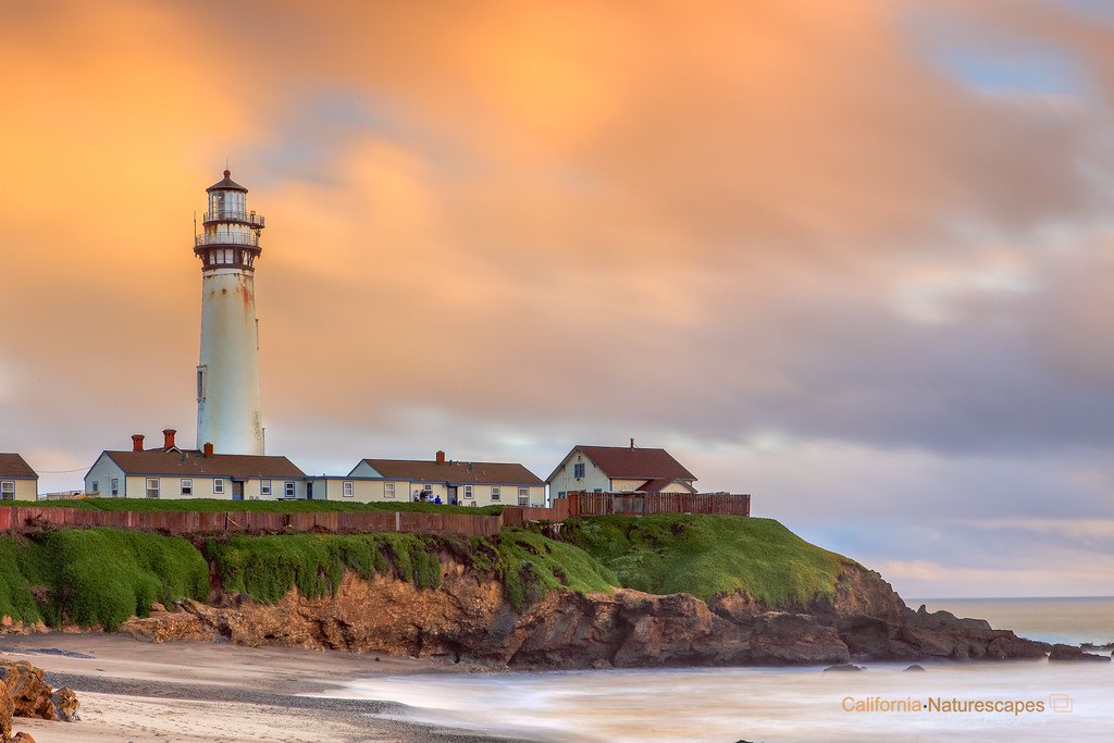 """Pigeon Point Lighthouse"" <br>Location: San Mateo Country, Highway 1, California.  <p><p>This lighthouse is an awesome place to photograph, especially during sunset. This is the image from the north side of the lighthouse. The sunset colors of the background clouds were looking great so I did a long exposure image to create a minimalist effect and further emphasize the lighthouse.  <p>Tech Info: <br>Lens: Canon EF 24-70mm f/2.8L @ 70mm <br>Camera: Canon EOS 5D Mk II <br>Exposure: 30sec at f/16 and ISO 50 <br>Filters: LEE ND Grads 0.9 and 0.6 <br>Post Processing: Adobe Lightroom, for saturation, white balance, levels and curves to bring out details in both shadow and highlight areas."