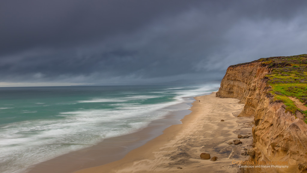 """Cliff View"" <br>Location: San Gregorio State Beach, San Mateo County, California.  <p><p>I have been looking for a place that gave a sense of vast open space. The long sandy shores of San Gregorio beach gave a perfect vantage point and during winter this beach is hardly visited, all of which helped create this image.  <p>Tech Info: <br>Lens: Canon EF 17-40mm f/4L @40mm <br>Camera: Canon 5D Mk II <br>Exposure: 5sec at f/11 and ISO 50 <br>Filters: SinghRay 2 stop ND grad hard edge  <p>California's coastal geology is unique. Within a span of few miles it is possible to see variations from rugged coastline to smooth sandy shores to dramatic cliffs as seen in this shot. This is one of the beaches where <a href=""http://www.jimdenevan.com/jim.htm"">Jim Denevan</a> has drawn in the past. What a view it would be to see his drawing from here... hopefully someday."