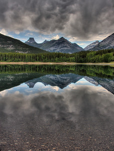 Wedge Pond at Kananaskis Country  in the Majestic Canadian Rockies. No trick photography, just a beautiful reflection before a huge storm ended my day of photography.
