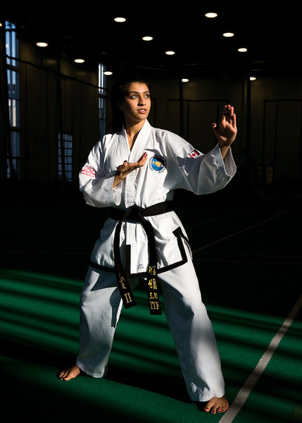 Sana, ITF Taekwon-do Competitor, Soccer Player, Community Event Organizer, 2011<br /> Signed, Limited Edition, Archival Giclee Print, 1/10<br /> $250 Unframed/$350 Framed<br /> <br /> Sana knows what she wants and does what it takes to get it. She's competed on the world stage in Taekwon-do, finished her joint honours bachelors' degree a year early, plays soccer, and is often the point person for community events. I hope my sons grow up with the same drive and initiative.