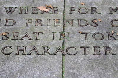 """Character"" jumped out from this bronze letter inlay at the Francis Parkman memorial across from Jamaica Pond, Boston."