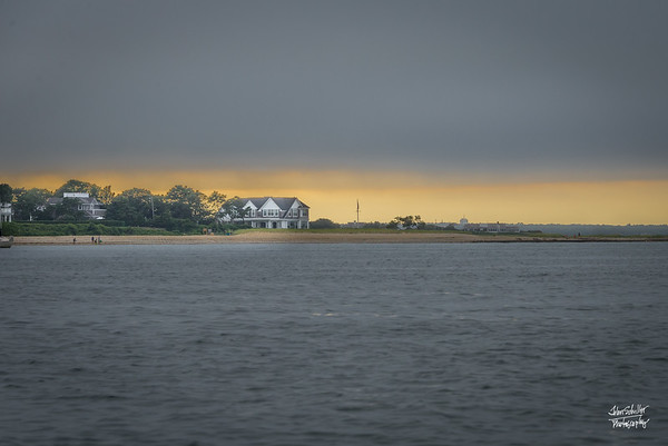 Sunset  highlighs the Vineyard near Edgartown, as a hazy cloud layer settles over Vineyard Sound.  Shot on August 11, 2017 © John Schiller Photography