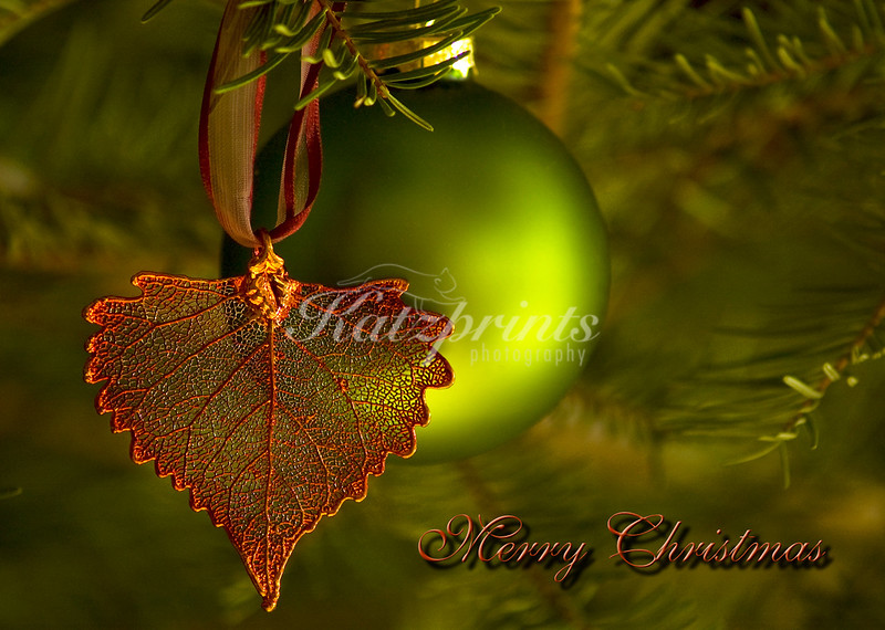 Copper leaf ornament and globe in a Christmas tree