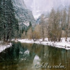 A calm Merced River reflects Yosemite Falls in winter