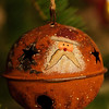 Metal globe with Santa face in Christmas tree