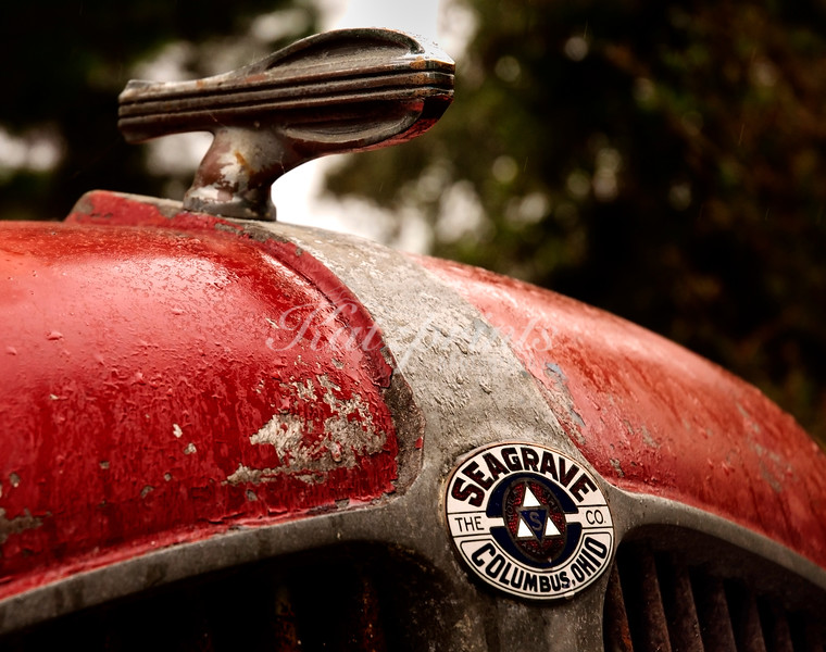 Rain falls onto an old Seagrave fire engine waiting for restoration in a California backyard.
