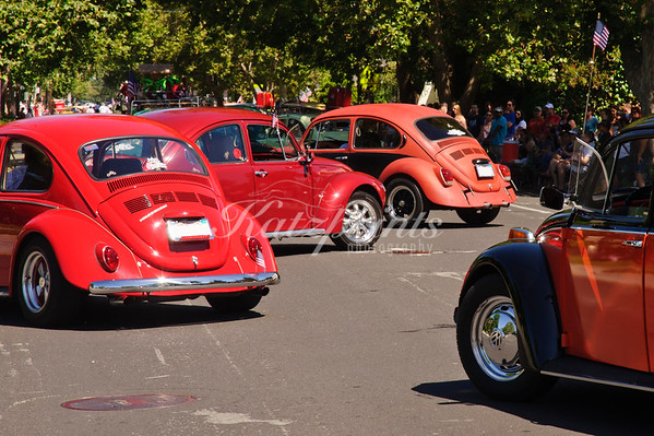 Red-orange Beetle Ballet at the 4th of July Rose, White and Blue Parade in San Jose
