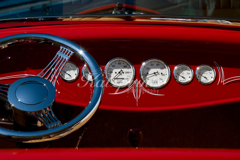 Dashboard and steering wheel of a classic car at the Pebble Beach Tour d'Elegance in Carmel