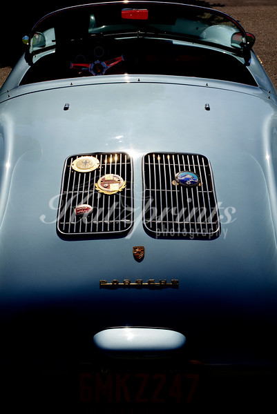 Rear view of a classic Porsche Spyder cabriolet with German badges