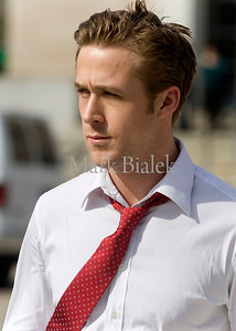 """Ryan Gosling walks from his trailer the the set of """"The Ides of March"""" in downtown Ann Arbor, Michigan on March 17, 2011.  Gosling's character in the movie is Stephen Myers.  (Photo by Mark Bialek)"""
