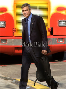 "George Clooney walks in front of a movie truck to the set of ""The Ides of March"" at the Michigan League in downtown Ann Arbor, Michigan on March 17, 2011.  Clooney is directing and also starring in the movie.  Next stop for filming is Bloomfield Hills.  (Photo by Mark Bialek)"
