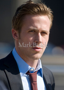 "Actor Ryan Gosling walks from the set of ""The Ides of March"" in downtown Ann Arbor, Michigan on March 16, 2011.  Gosling's character in the movie is Stephen Myers and the film is being directed by George Clooney."