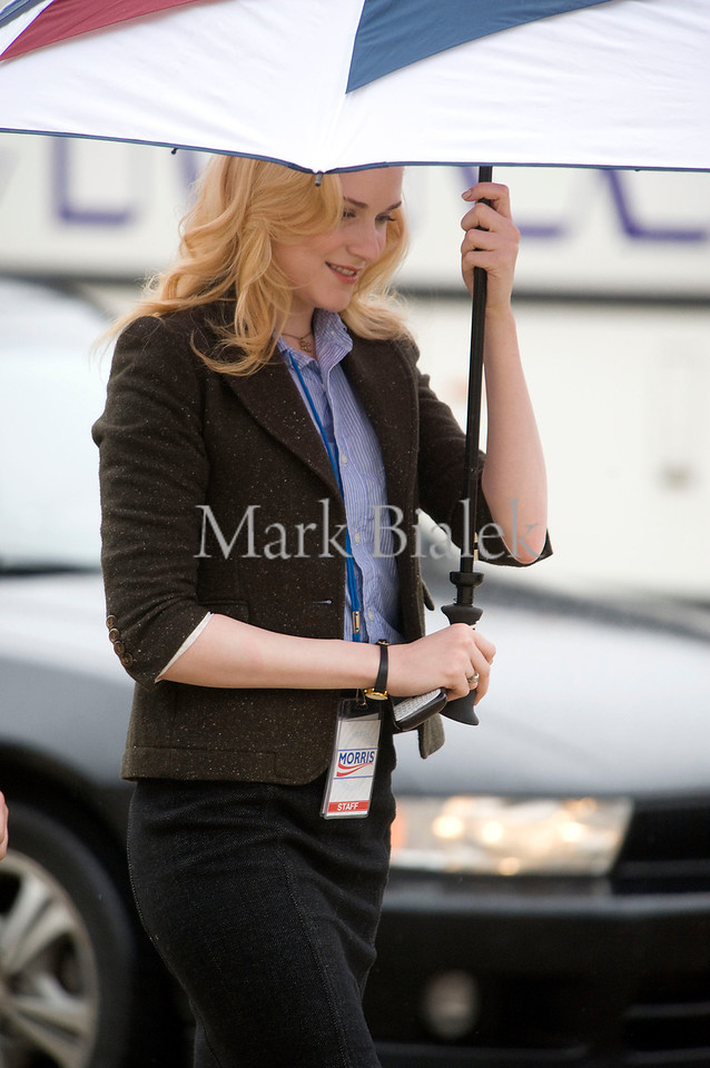 """Actress Evan Rachel Wood tries to cover up from the rain while on a break from filming """"The Ides of March"""" in downtown Ann Arbor, Michigan on March 15, 2011.  Wood is playing """"Molly Stearns"""" and is co-starring alongside George Clooney, (also directing) Paul Giamatti, Ryan Gosling, Marisa Tomei, and Philip Seymour Hoffman."""
