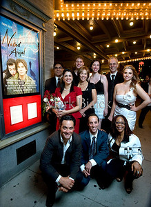"The cast of the movie ""Naked Angel"" pose for a picture at the movie's premier at Michigan Theater in Ann Arbor, MI."