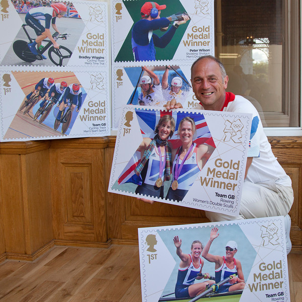 Sir Steve Redgrave with the first 6 of Royal Mai's 2012 Gold Medal stamps.