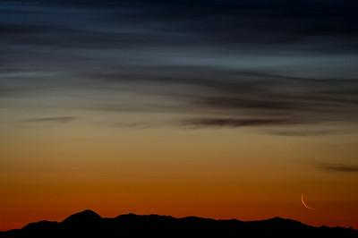 Moon sliver over Sleeping Ute Mountain