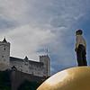 Hohensalzburg Fortress and globe sculpture in Salzburg, Austria