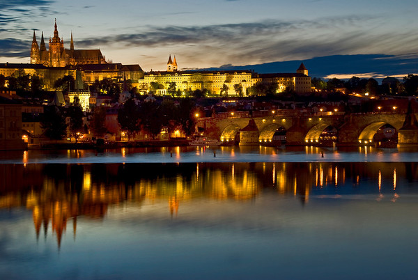 Prague Castle at night, reflected in the Vltava River