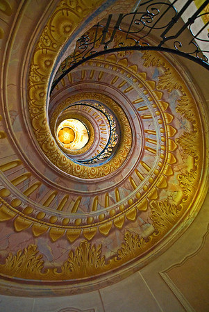 Spiral staircase in the Austrian Benedictine abbey, in the town of Melk, on a rocky outcrop overlooking the river Danube in Austria, adjoining the Wachau valley.   Melk, Austria