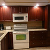 New... all wood cabinets and granite counter tops.