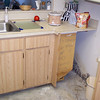 Before... old laminate cabinets and laminate counters.