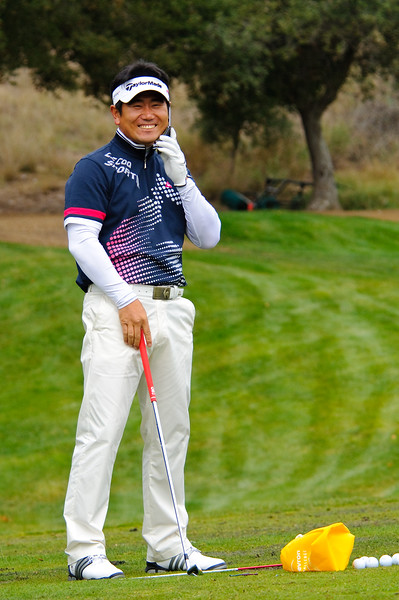 Y.E. Yang on a cell phone at Sherwood Country Club