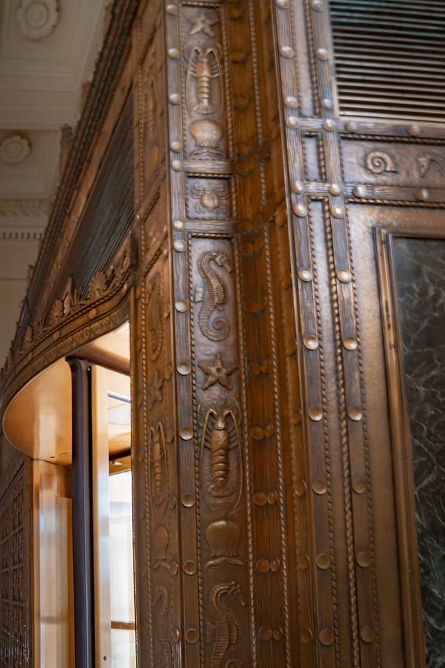 Ornate wooden revolving doors at the entrance to Shedd Aquarium