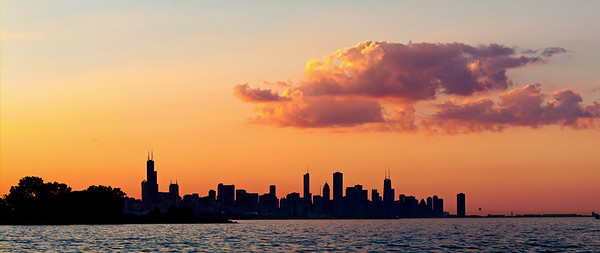 View of Chicago skyline at sunset from Promontory Point