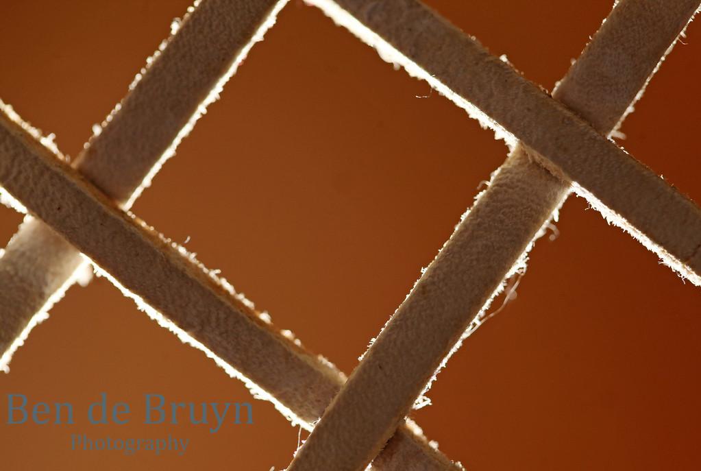 Abstract cross againts a burnt orange background -  salvation via Jesus Christ resurrection