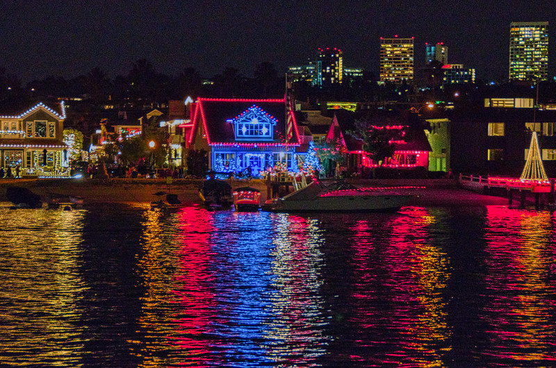 Homes lighted for Christmas line the shore at Newport Beach, CA