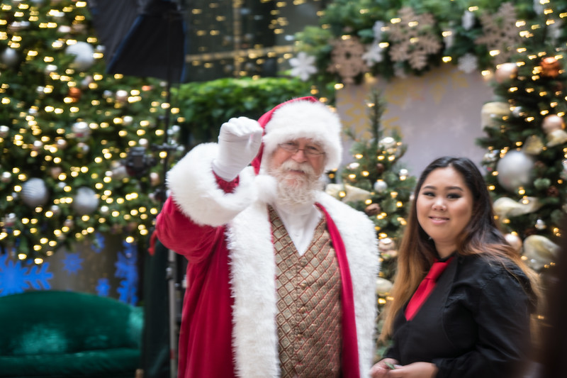 A friendly wave from Santa at the mall.