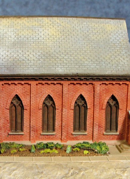 Detail view - brick, window and slate shingles.
