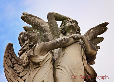Metairie Cemetery Metairie, LA Marble angels clasping each other over a tomb of Aldige family died in sinking of a steamer La Bourgoyne in 1898