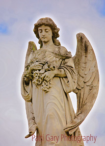 An angel on a tomb of G. V. del Corral, in Metairie Cemetery. New Orleans, Louisiana