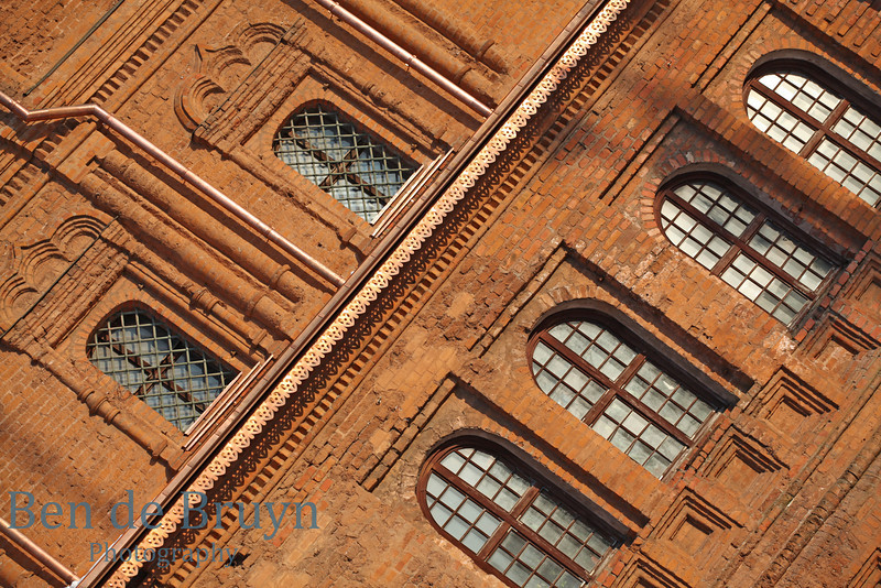 Bright sunshine on red brick wall of orthodox church and monastery of Our Lady of the Sign in Moscow Russia
