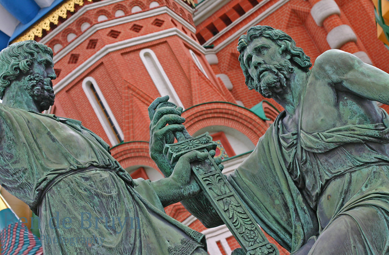 Statute in front of orthodox church Cathedral St. Vasily the Blessed (Saint Basil's) on Red Square in Moscow Russia on overcast day