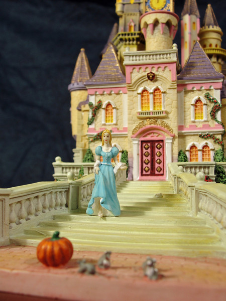 Close-up of Cinderella with mice and pumpkin coach.