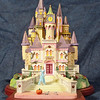 Lenox Collections - Cinderella's Palace - copyright<br /> This elaborate, forced perspective sculpture took a great deal of planning, designing and sculpting and is based on only two concept sketches supplied by Lenox.  Many of the finely sculpted details were prominently showcased in the marketing brochures and advertising.
