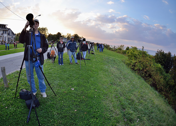 Photographer getting ready to shoot the Full Moon Rising over Cleveland Ohio
