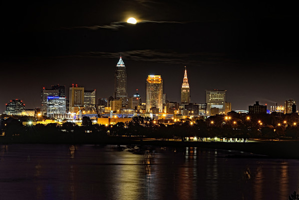 Moon peeking out from a cloud over Cleveland, Ohio