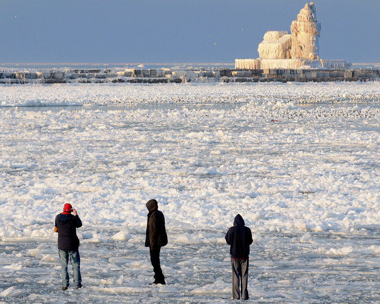 Ice Walkers at the Cleveland's Frozen Lighthouse