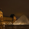 The Louvre Plaza at Night - Paris, France.