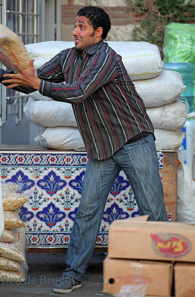 Istanbul: Spice Market - Man moving products for market stall