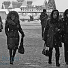 Women walking through the Resurrection Gate Red Square Moscow Russia on very cold winter day