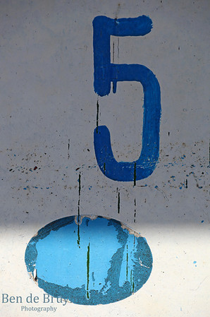 Number five sign on white background with cracked paint