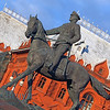 State Historical Museum of Russia on sunshine day with blue sky in summer with statute of soldier and horse