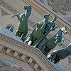 Bolshoi ballet theater and horse statute in bright sunshine in Moscow Russia